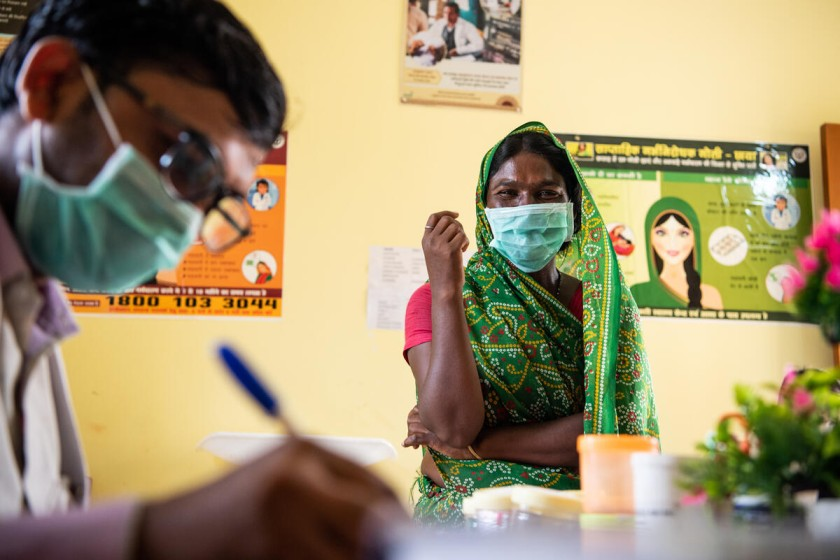 A woman at a community health centre in Uttar Pradesh during India's COVID-19 response