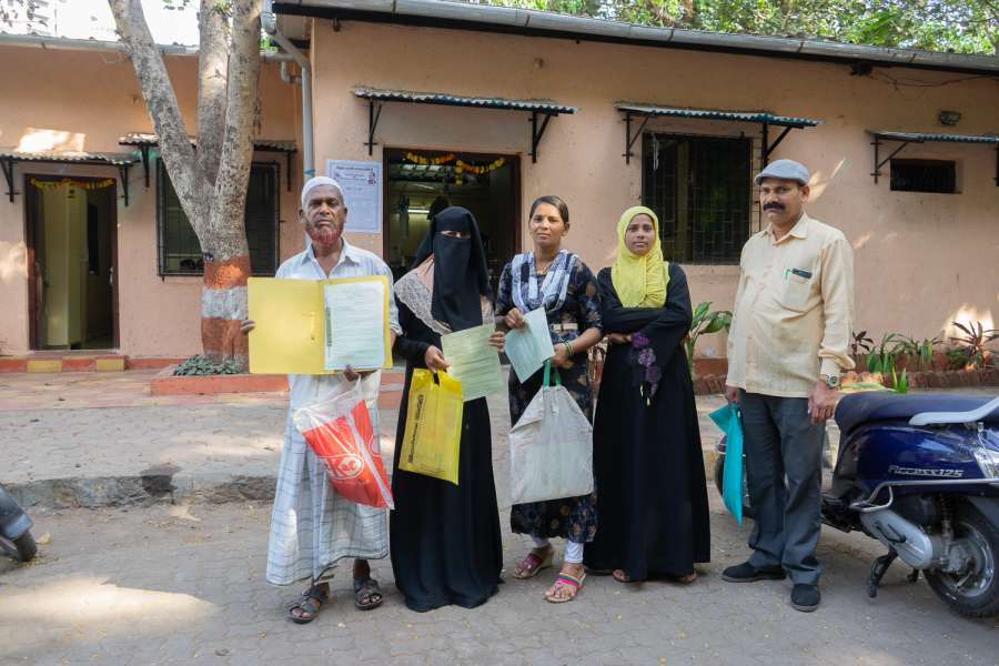 Image 13_people standing next to each other holding documents-water for all_picture courtesy-Suraj Katra