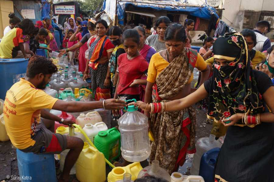 Image 8_people standing in line getting their water filled-water for all-picture courtesy-Suraj Katra