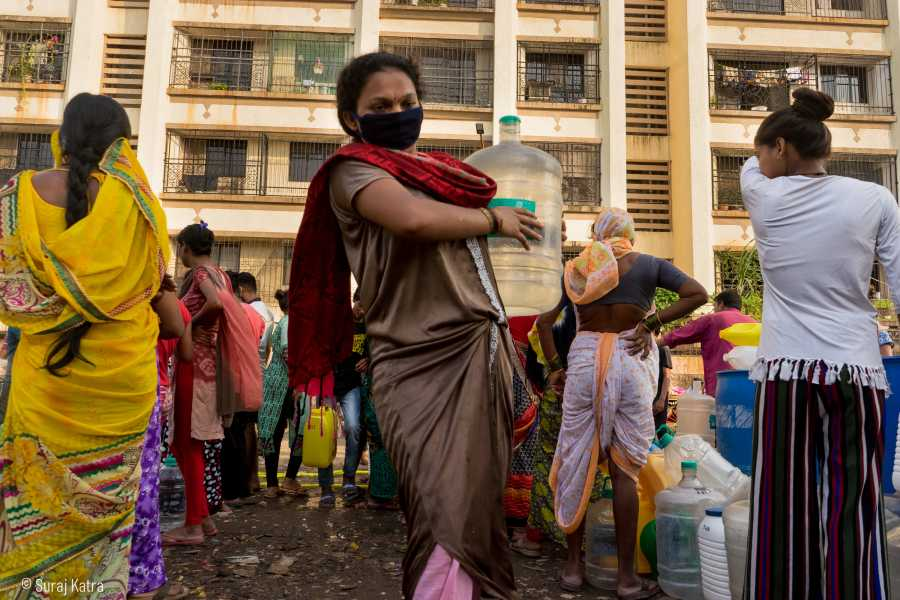 Image 9_ woman wearing a mask carrying a water container-water for all-picture courtesy Suraj Katra