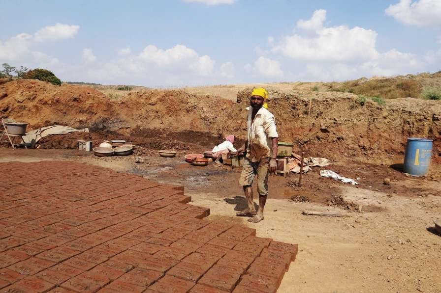 Worker-laying bricks-labour codes-picture courtesy-pixabay_ government survey