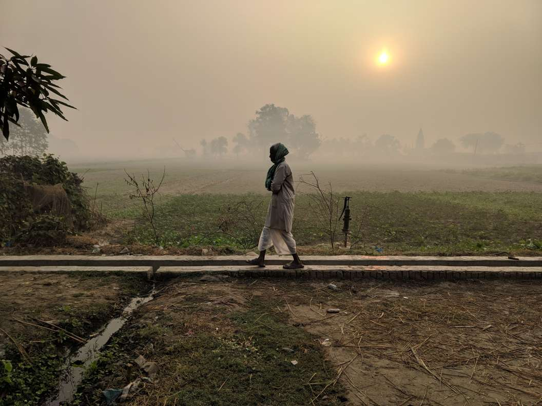 person walking across a field_Pixabay_COVID-19 panchayats