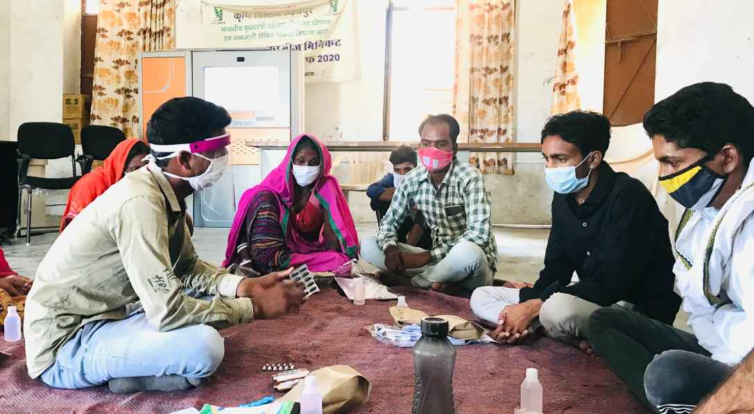 Volunteers gathered around in a circle wearing masks attending training-Picture courtesy: Basic Health Services-vaccine hesitancy-rural Rajasthan