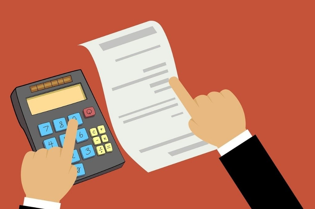 Image of a finger of the left hand on number 9 on a calculator and finger of the right hand on a while sheet_Mohamed Hassan-section 80G of income tax act