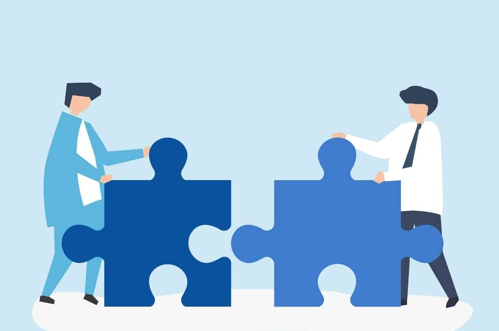 colleagues-connecting-jigsaw-pieces-together-social sector government