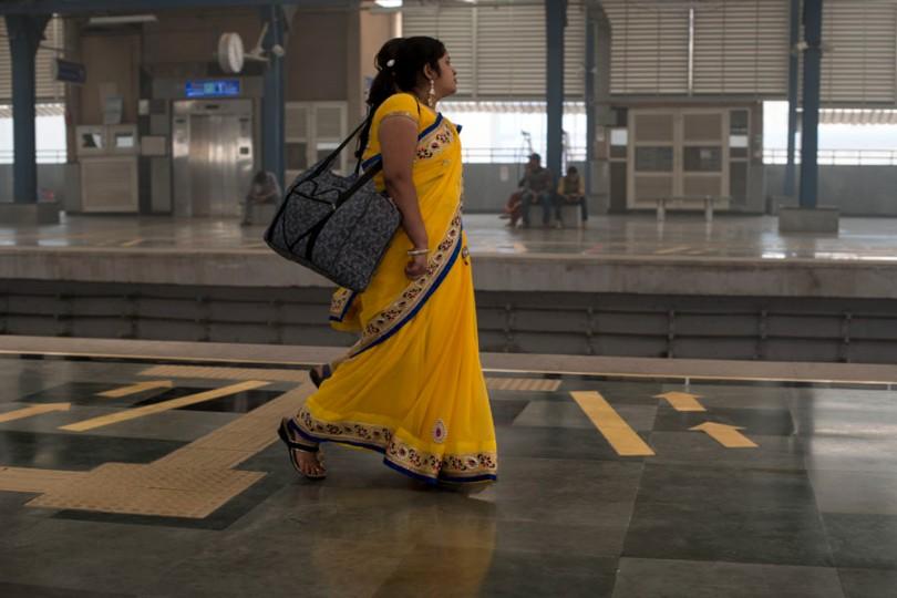 Woman walking on the platform at delhi metro-urban employment scheme-picture courtesy: Flickr