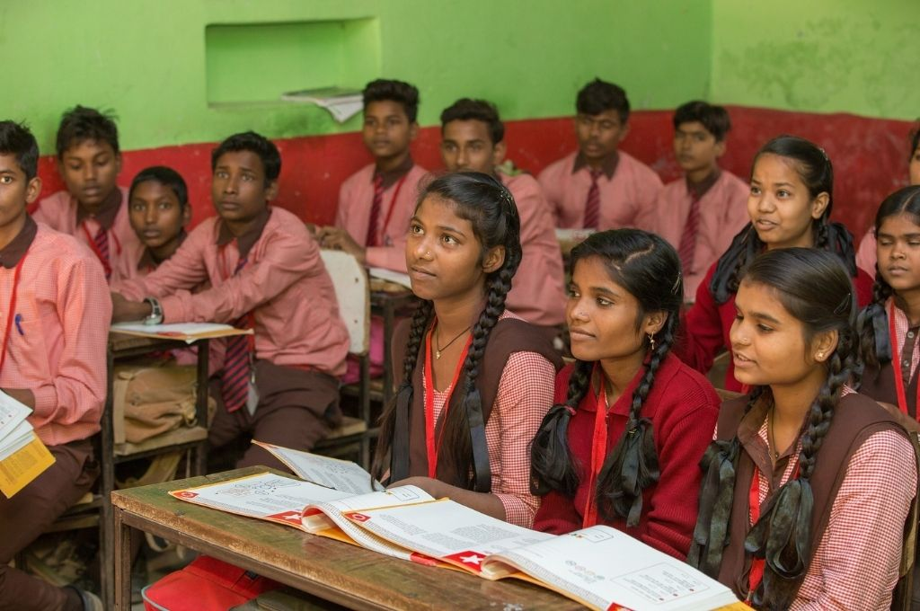young-school-students-sitting-in-a-classroom-gender norms