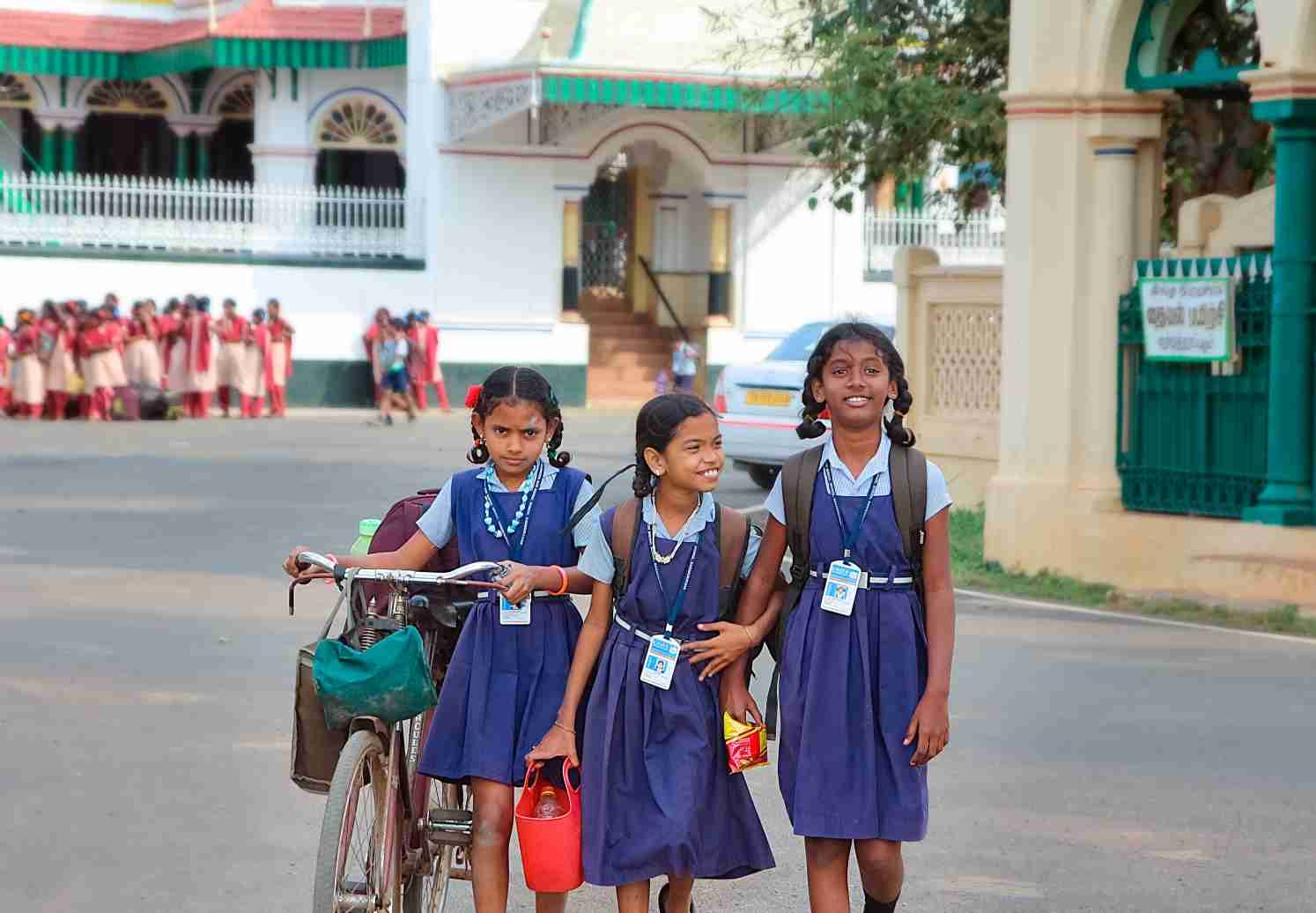 Three girls in primary school uniforms walking together_ Picture courtesy-Flickr