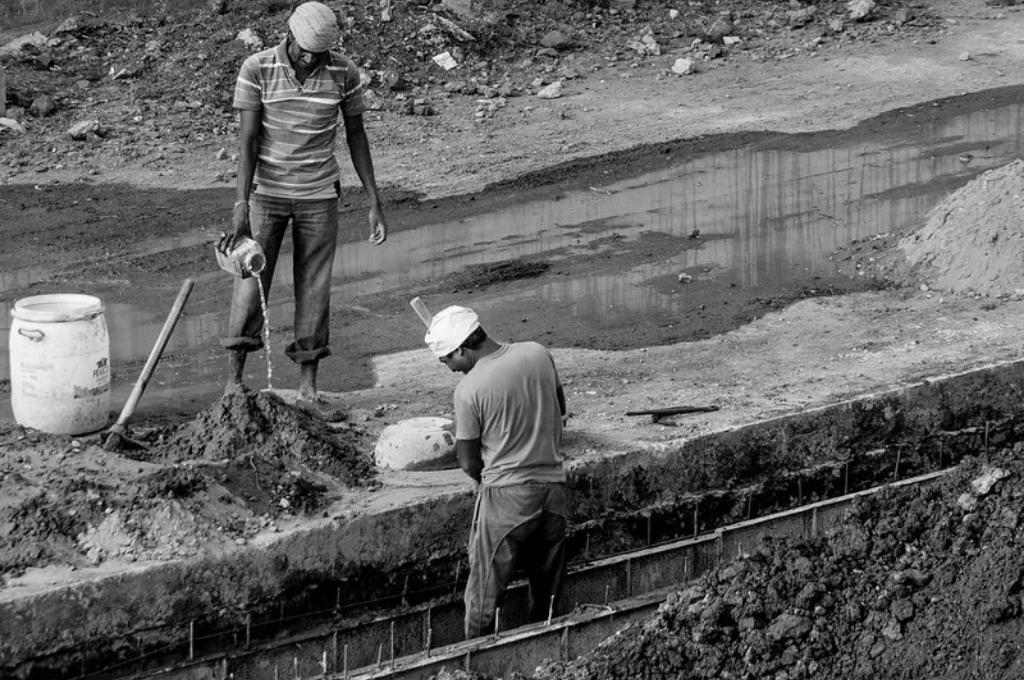 two construction workers working on a site-BOCW card