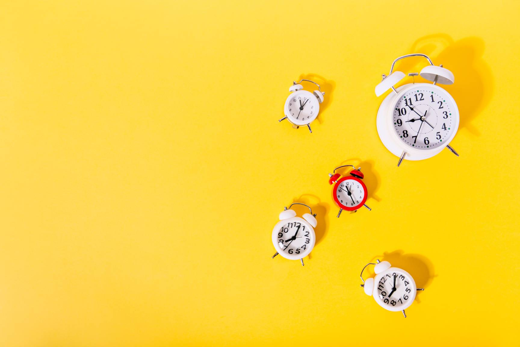alarm clocks against a yellow background-timelines