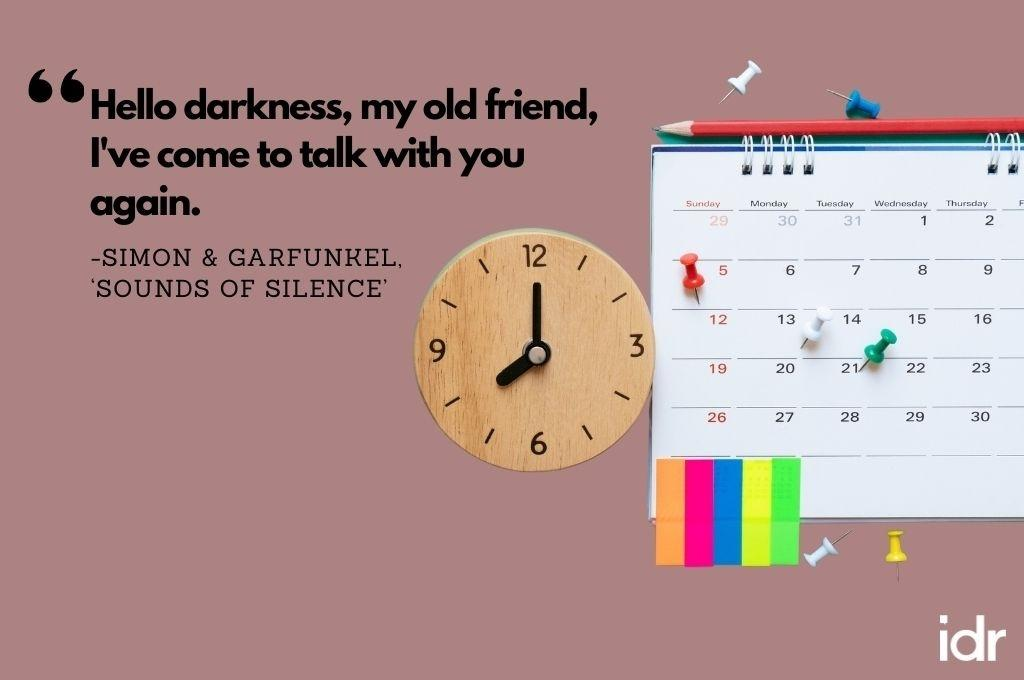 """There is a calendar, with a pencil on top, push pins on it, and some post it notes stuck on the bottom. On its left, there is a clock. The quote on the image reads, """"Hello darkness, my old friend, I've come to talk with you again. By Simon and Garfunkel, """"Sounds of silence""""-workweek playlist"""