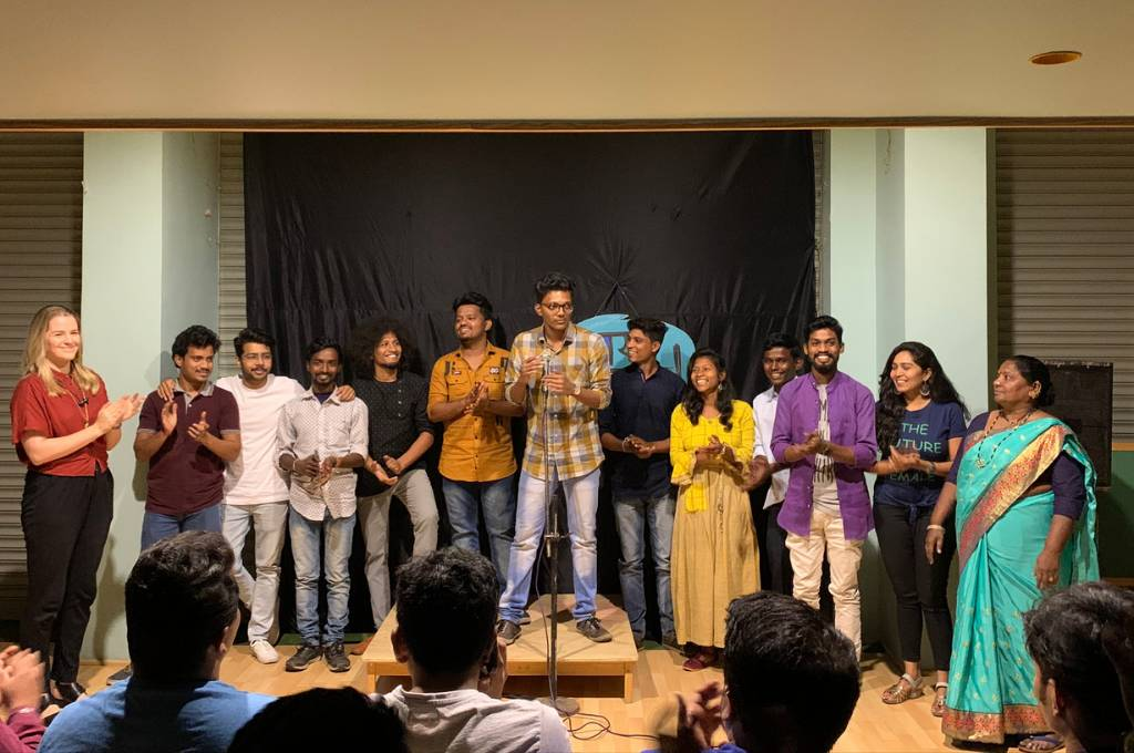 Group of performers of the Marathi comedy show, Kay Boltay, in front of an audience. The group is made up of men and women. Nonprofits often fund arts as drivers of social change, adding predetermined meanings to the performance. This Marathi comedy programme sought to be different.