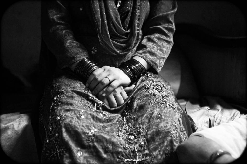 black and white photo of a woman with hands on top of each other. Picture credits: Charlotte Anderson-grief and death children