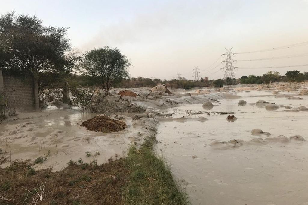Flyash flooding fields in the aftermath of the Reliance Sasan Ultra Mega Power Project breach at Sasan-