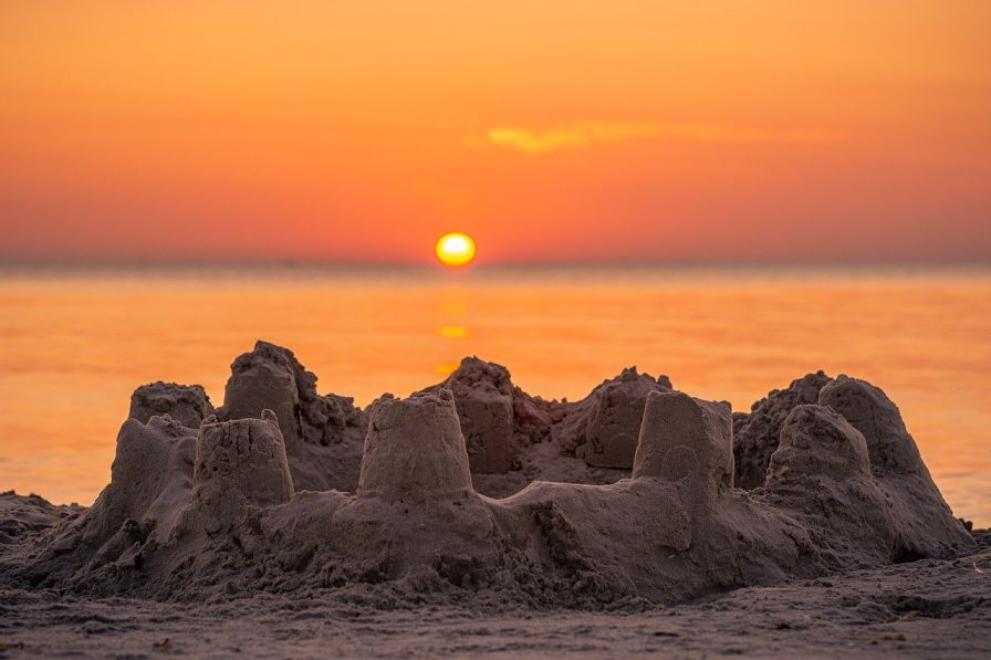 Image of a sandcastle in the foreground-social impact-