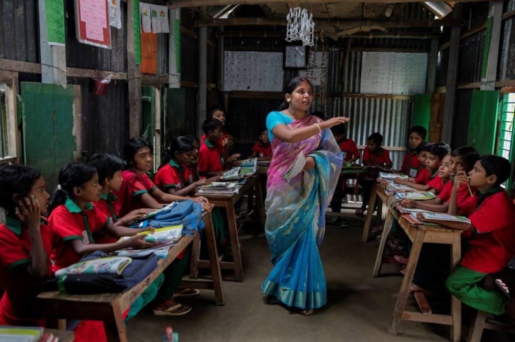 students listen to their teacher-
